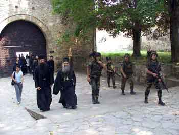 Leaving the monastery under  guard