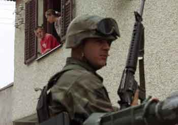 Serbs locked in their homes and guarded by NATO