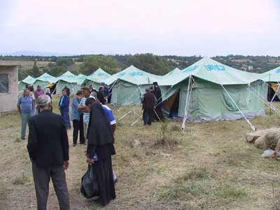 The returnees in front of UNHCR tents