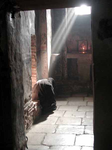 A Gracanica nun in prayer
