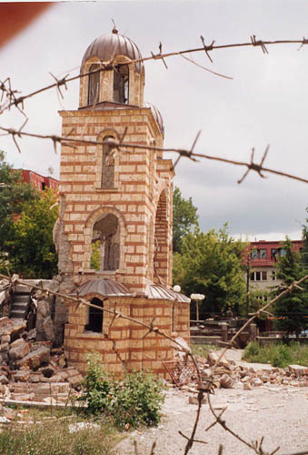 The ruins of Djakovica Cathedral surrounded by barbed wire